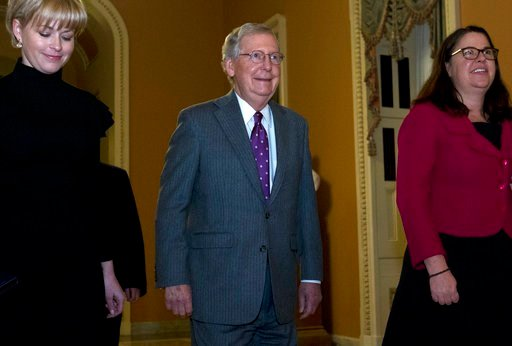 (AP Photo/Jose Luis Magana). Senate Majority Leader Mitch McConnell, R-Ky., walks to the senate chamber minutes before the midnight, at the Capitol, Thursday, Feb. 8, 2018, in Washington.