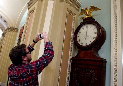 (AP Photo/Jose Luis Magana). Photographers take a picture of the Ohio Clock shortly after midnight early Friday, Feb. 9, 2018, outside the Senate chamber at the Capitol, in Washington.