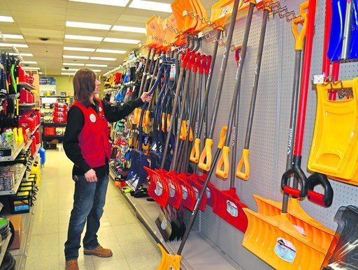 (Jon Gard/The News Dispatch via AP). Andrew Brown, assistant manager at Kabelin Ace Hardware, looks through the store's variety of snow shovels ahead of another snowstorm, Thursday, Feb. 8, 2018, in La Porte, Ind.