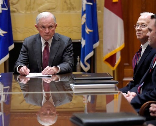 (AP Photo/Susan Walsh, Pool). FILE - In this Feb. 9, 2017 file photo, Attorney General Jeff Sessions, left, holds a meeting with the heads of federal law enforcement components at the Department of Justice in Washington,.  Acting Deputy Attorney Genera...