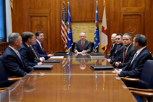 (AP Photo/Susan Walsh, Pool). FILE - In this Feb. 9, 2017 file photo, Attorney General Jeff Sessions holds a meeting with the heads of federal law enforcement components at the Department of Justice in Washington, Thursday, Feb. 9, 2017. Seated at the ...