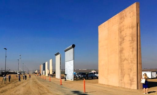 (AP Photo/Elliott Spagat, File). FILE - This Oct. 26, 2017 file photo shows prototypes of border walls in San Diego. Federal Judge Gonzalo Curiel was berated by Donald Trump for his handling of lawsuits alleging fraud at now-defunct Trump University. C...