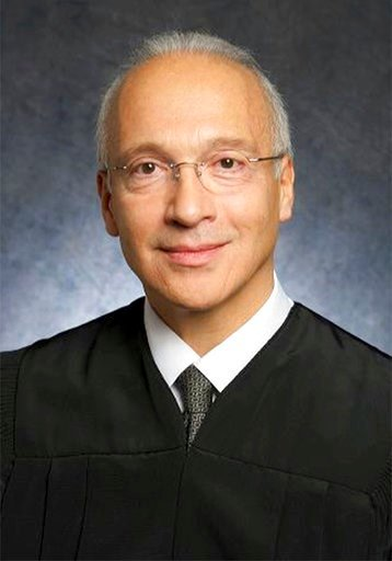 (U.S. District Court via AP, File). FILE - This undated file photo provided by the U.S. District Court shows Federal Judge Gonzalo Curiel. Curiel was berated by Donald Trump for his handling of lawsuits alleging fraud at now-defunct Trump University. H...