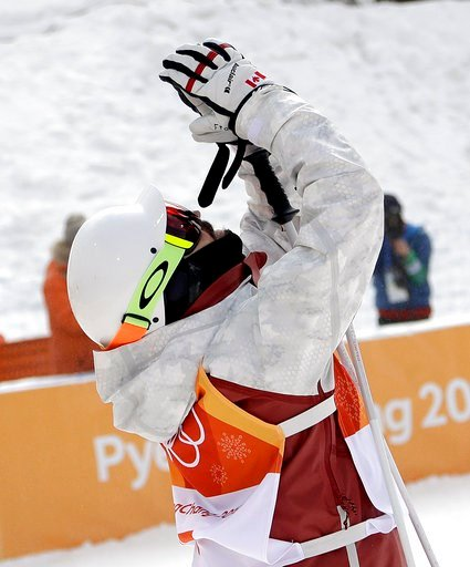 (AP Photo/Gregory Bull). Philippe Marquis, of Canada, reacts after crossing the finish line during the men's moguls qualifying at Phoenix Snow Park at the 2018 Winter Olympics in Pyeongchang, South Korea, Friday, Feb. 9, 2018.