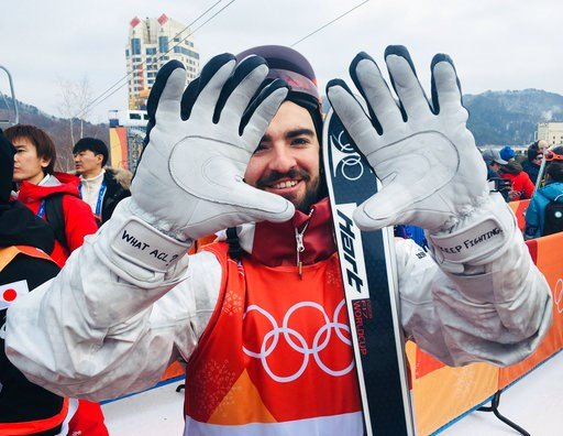 (AP Photo/Will Graves). Philippe Marquis, of Canada, shows his motivational notes he wrote on his gloves before qualifying for the men's moguls at Phoenix Snow Park at the 2018 Winter Olympics in Pyeongchang, South Korea, Friday, Feb. 9, 2018. Marquis ...