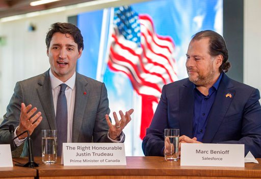 (Ryan Remiorz/The Canadian Press via AP). Canadian Prime Minister Justin Trudeau takes part in a roundtable discussion with Salesforce chief executive Marc Benioff in San Francisco on Thursday, Feb. 8, 2018.