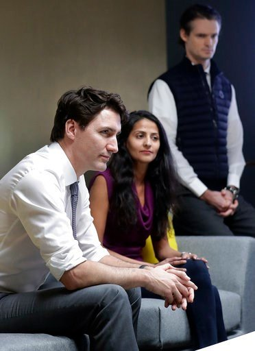 "(AP Photo/Jeff Chiu). Canada's Prime Minister Justin Trudeau, left, speaks with AppDirect employees at their office in San Francisco, Thursday, Feb. 8, 2018. Canadian Prime Minister Justin Trudeau brings what some call his ""maple charm offensive"" to Sa..."