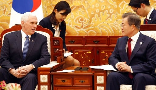 (Kim Hee-chul/Pool Photo via AP). U.S. Vice President Mike Pence, left, speaks with South Korean President Moon Jae-in during a meeting at the presidential office Blue House in Seoul Thursday, Feb. 8, 2018.