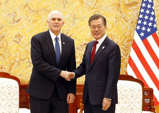 (Kim Hee-chul/Pool Photo via AP). U.S. Vice President Mike Pence, left, shakes hands with South Korean President Moon Jae-in prior to their meeting at the presidential office Blue House in Seoul Thursday, Feb. 8, 2018.