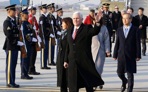 (AP Photo/Ahn Young-joon. Pool). U.S. Vice President Mike Pence waves upon his arrival at Osan Air Base in Pyeongtaek, South Korea, Thursday, Feb. 8, 2018.