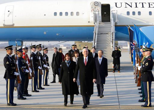 (AP Photo/Ahn Young-joon. Pool). U.S. Vice President Mike Pence and his wife Karen Pence arrive at Osan Air Base in Pyeongtaek, South Korea, Thursday, Feb. 8, 2018.