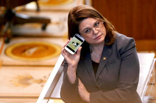(Anna Reed/Statesman-Journal via AP, File). FILE - In this March 3, 2016, file photo, Oregon state Sen. Sara Gelser listens to a live stream as members of the House of Representatives finish business before adjourning the 2016 legislative session at th...