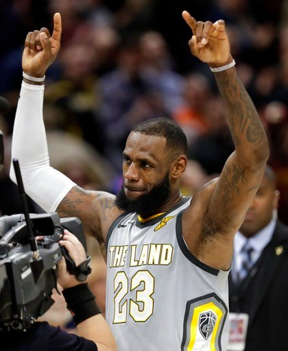 (AP Photo/Tony Dejak). Cleveland Cavaliers' LeBron James, left, celebrates after making the game-winning basket in overtime in an NBA basketball game against the Minnesota Timberwolves, Wednesday, Feb. 7, 2018, in Cleveland. The Cavaliers won 140-138 i...