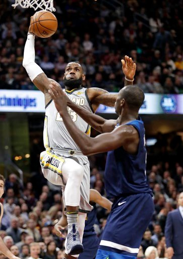 (AP Photo/Tony Dejak). Cleveland Cavaliers' LeBron James, left, drives to the basket against Minnesota Timberwolves' Gorgui Dieng, from Senegal, in the first half of an NBA basketball game, Wednesday, Feb. 7, 2018, in Cleveland.
