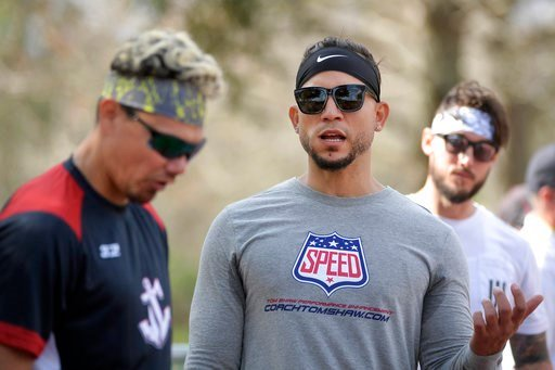 (AP Photo/Phelan M. Ebenhack). Professional baseball players Jose Lobaton, left, Carlos Gonzalez, center, and Jordan Schafer take a break at the Coach Tom Shaw Performance camp Monday, Jan. 22, 2018, in Lake Buena Vista, Fla.
