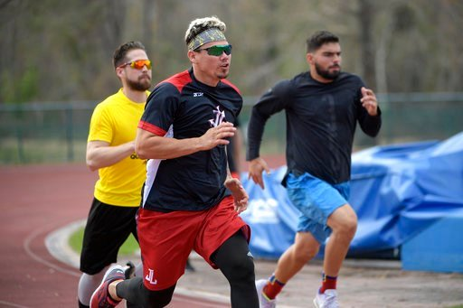 (AP Photo/Phelan M. Ebenhack). Professional baseball players Jose Lobaton, center, Ender Inciarte, left, and Mauro Conde work out at the Coach Tom Shaw Performance camp Monday, Jan. 22, 2018, in Lake Buena Vista, Fla.