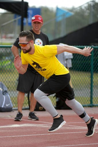 (AP Photo/Phelan M. Ebenhack). Professional baseball player Ender Inciarte runs as performance coach Tom Shaw watches, while applying football training techniques Monday, Jan. 22, 2018, in Lake Buena Vista, Fla. Coming off an All-Star season with the A...
