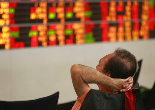 (AP Photo/Sakchai Lalit). A Thai investor sits in front of an electronic board showing stock prices at a private stock trading floor in Bangkok, Thailand, Friday, Feb. 9, 2018. China's stock market benchmark plunged 5.5 percent on Friday and other Asia...