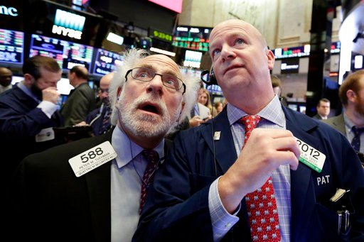 (AP Photo/Richard Drew). Traders Peter Tuchman, left, and Patrick Casey work on the floor of the New York Stock Exchange, Thursday, Feb. 8, 2018. U.S. stocks are lower Thursday morning as losses from the previous day continue.