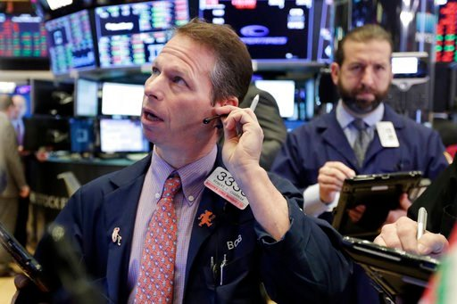 (AP Photo/Richard Drew). Trader Robert Charmak, left, works on the floor of the New York Stock Exchange, Thursday, Feb. 8, 2018. U.S. stocks are lower Thursday morning as losses from the previous day continue.