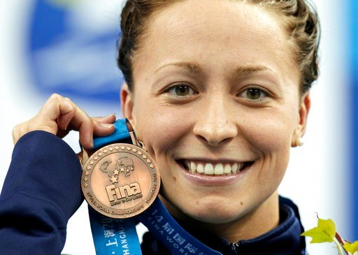 (AP Photo/Michael Sohn, File). FILE - In this July 25, 2011, file photo, Ariana Kukors, of the United States, holds her bronze medal for the women's 200-meter Individual Medley final at the FINA 2011 Swimming World Championships in Shanghai, China. The...