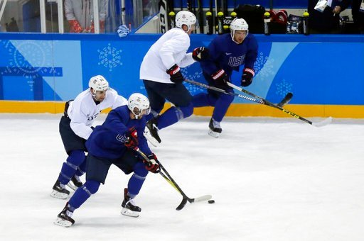 (AP Photo/Kiichiro Sato). United State's Ryan Gunderson battles controls the puck against Mark Arcobello, left, during practice ahead of the 2018 Winter Olympics in Gangneung, South Korea, Friday, Feb. 9, 2018.