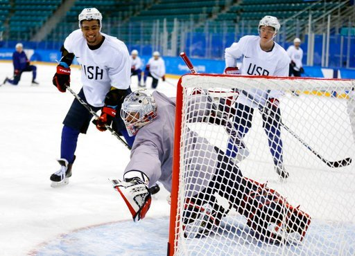 (AP Photo/Kiichiro Sato). United State's goalie Brandon Maxwell reaches for a puck as Jordan Greenway, left, and Ryan Donato watch during practice ahead of the 2018 Winter Olympics in Gangneung, South Korea, Friday, Feb. 9, 2018.