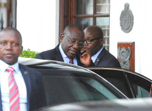 (AP Photo/Brenton Geach). South African Deputy President Cyril Ramaphosa, on phone, leaves parliament in Cape Town, South Africa, Wednesday, Feb 7, 2018. President Jacob Zuma's exit from power because of scandals appears to be getting closer Ramaphosa,...