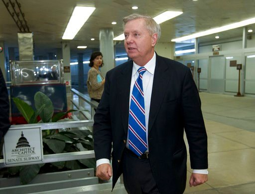 (AP Photo/Jose Luis Magana). Sen. Lindsey Graham, R-S.C., walks to the senate chamber, Friday, Feb. 9, 2018, at Capitol Hill in Washington.
