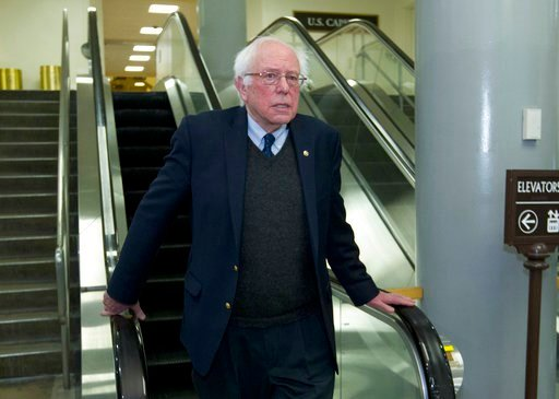 (AP Photo/Jose Luis Magana). Sen. Bernie Sanders, I-Vt., walks to his office, Friday, Feb. 9, 2018, at Capitol Hill in Washington.