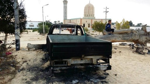 (AP Photo/Tarek Samy, File). FILE - In this Nov. 25, 2017 file photo, a burned truck is seen outside Al-Rawda Mosque in Bir al-Abd northern Sinai, Egypt a day after attackers killed hundreds of worshippers. Egypt's military says it has begun a major se...