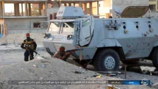 (Islamic State Group in Sinai, via AP, File). FILE -This photo posted on a file sharing website Wednesday, Jan. 11, 2017, by the Islamic State Group in Sinai, a militant organization, shows a deadly attack by militants on an Egyptian police checkpoint,...