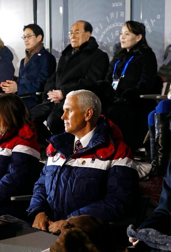 (AP Photo/Patrick Semansky, Pool). Vice President Mike Pence, bottom, watches the opening ceremony of the 2018 Winter Olympics in Pyeongchang, South Korea, Friday, Feb. 9, 2018. Seated behind Pence are Kim Yo Jong, top right, sister of North Korean lea...