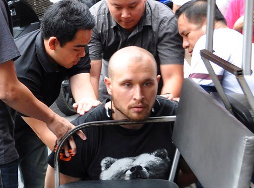 (Crime Suppression Division of the Thailand via AP). In this Friday, Feb. 2, 2018, photo released by the Crime Suppression Division of the Thailand Police, Sergey Medvedev, 31, center, is arrested outside an apartment in his role in an international id...