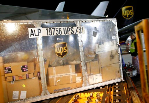 (AP Photo/Patrick Semansky). In this Nov. 20, 2015 picture, a UPS airplane is unloaded at the company's Worldport hub in Louisville, Ky. Shares of delivery companies FedEx and UPS are falling in Friday, Feb. 9, 2018, premarket trading following a repor...
