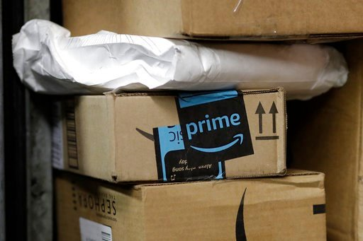 (AP Photo/Mark Lennihan, File). FILE- In this May 9, 2017, file photo, a package from Amazon Prime is loaded for delivery on a UPS truck, in New York. Shares of delivery companies FedEx and UPS are falling in Friday, Feb. 9, 2018, premarket trading fol...