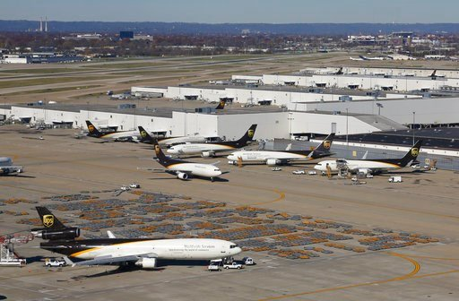 (AP Photo/Patrick Semansky). In this Nov. 20, 2015 picture, UPS airplanes sit on a tarmac at the company's Worldport hub in Louisville, Ky. Shares of delivery companies FedEx and UPS are falling in Friday, Feb. 9, 2018, premarket trading following a re...