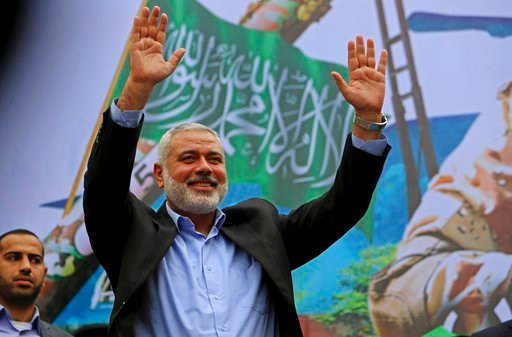 (AP Photo/Adel Hana, File). File - In this Friday, Dec. 12, 2014 file photo, Palestinian top Hamas leader Ismail Haniyeh greets supporters during a rally to commemorate the 27th anniversary of the Hamas militant group, at the main road in Jebaliya in t...