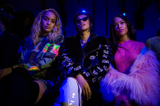 (AP Photo/Andres Kudacki). Jasmine Sanders, from left, Cardi B and Serayah McNeill attend the Jeremy Scott show during Fashion Week in New York, Thursday, Feb. 8, 2018.