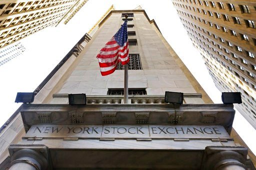 (AP Photo/Richard Drew, File). FILE - In this Nov. 13, 2015, file photo, the American flag flies above the Wall Street entrance to the New York Stock Exchange. The U.S. stock market opens at 9:30 a.m. EST on Friday, Feb. 9, 2018.