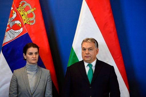 (Zsolt Szigetvary/MTI via AP). Hungarian Prime Minister Viktor Orban, right, and Prime Minister of Serbia Ana Brnabic participate in a signing ceremony following a bilateral governmental summit of Hungary and Serbia in Budapest, Hungary, Friday, Feb. 9...