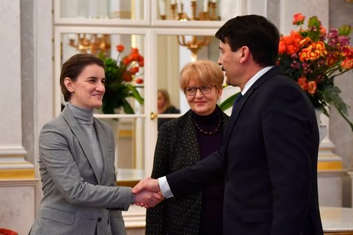 (Tibor Illyes/MTI via AP). Serbian Prime Minister Ana Brnabic, left, shakes hands with Hungarian President Janos Ader during their meeting in the presidential Alexander Palace in Budapest, Hungary, Friday, Feb. 9, 2018.