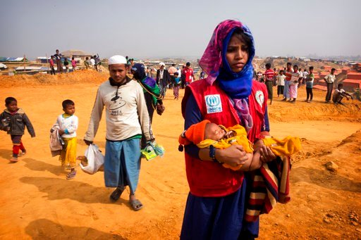 (AP Photo/Manish Swarup). In this Sunday, Jan. 14, 2018, photo, a volunteer carries a malnourished child from a newly arrived Rohingya family to a transit camp in the Kutupalong refugee camp near Cox's Bazar, Bangladesh. The hunger the Rohingya faced a...