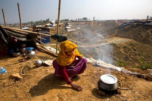 (AP Photo/Manish Swarup). In this Saturday, Jan. 13, 2018, photo, a newly arrived Rohingya woman makes rice for her family at Balukhali refugee camp near Cox's Bazar, Bangladesh.