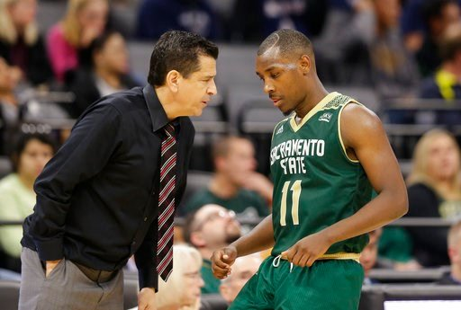 (AP Photo/Rich Pedroncelli,file ). FILE -  In this Nov. 21, 2017, file photo, Sacramento State guard Kevin Hicks talks with head coach Brian Katz during the second half of an NCAA college basketball game against the University of California, Davis, in ...