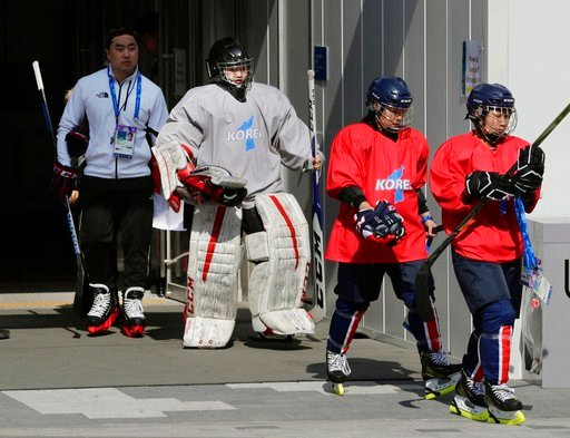 (AP Photo/Frank Franklin II). Members of the combined Koreas women's hockey team walk from the Kwandong Hockey Centre to the training center to practice prior to the 2018 Winter Olympics in Gangneung, South Korea, Friday, Feb. 9, 2018.