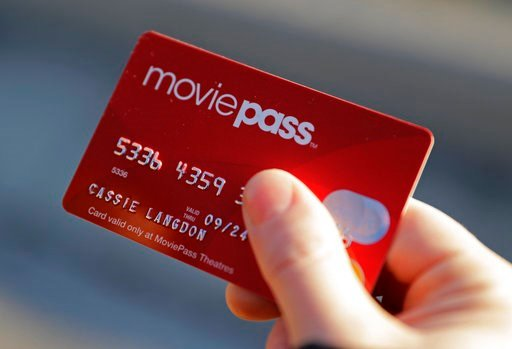 (AP Photo/Darron Cummings).Cassie Langdon holds her MoviePass card outside AMC Indianapolis 17 theatre in Indianapolis.