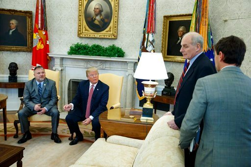 (AP Photo/Evan Vucci). President Donald Trump speaks with White House Chief of Staff John Kelly, second from right, and White House deputy press secretary Hogan Gidley, right, after meeting with Don Bouvet, left, in the Oval Office of the White House, ...