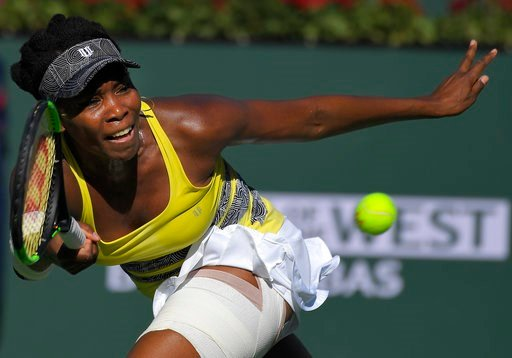 (AP Photo/Mark J. Terrill, File). FILE - In this March 13, 2017, file photo, Venus Williams returns a shot to Lucie Safarova, of the Czech Republic, at the BNP Paribas Open tennis tournament, in Indian Wells, Calif. Five months after becoming a mother,...