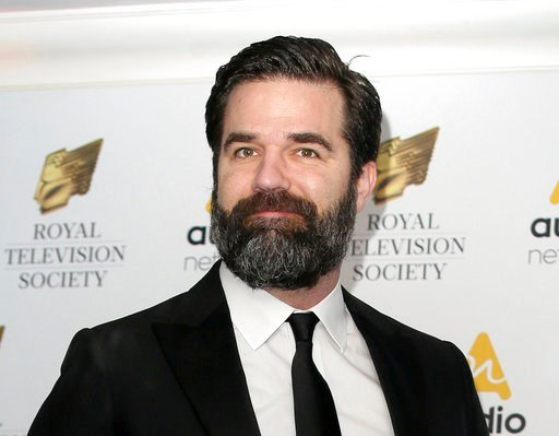 (AP Photos/Tim Ireland, File). FILE - In this March 21, 2017 file photo, Rob Delaney poses for photographers upon arrival at the Royal Television Society Programme Awards in London. Delaney has announced the death of his infant son from cancer.